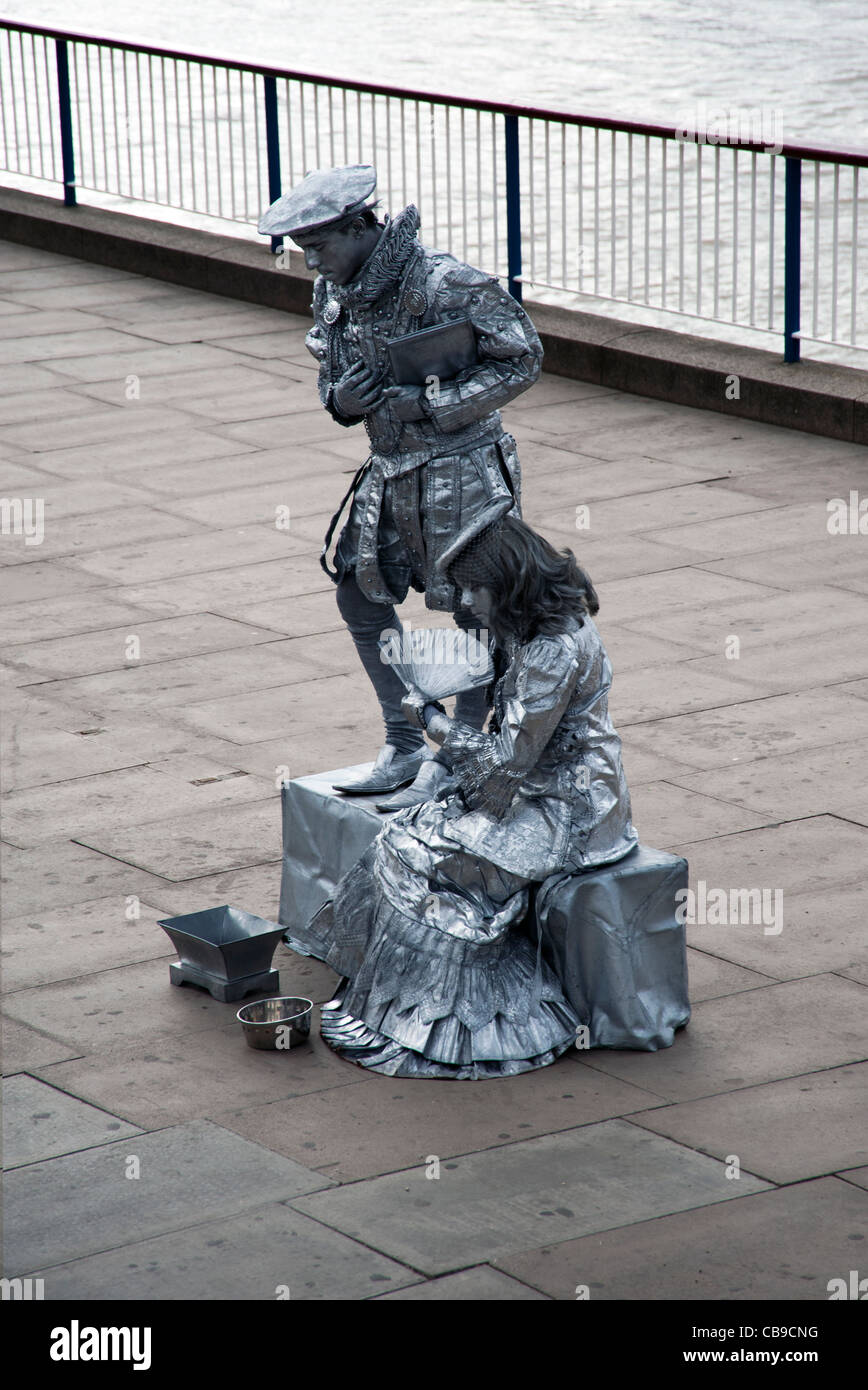 Performance artists or street performers on the Thames Path walk, London, UK - Stock Image