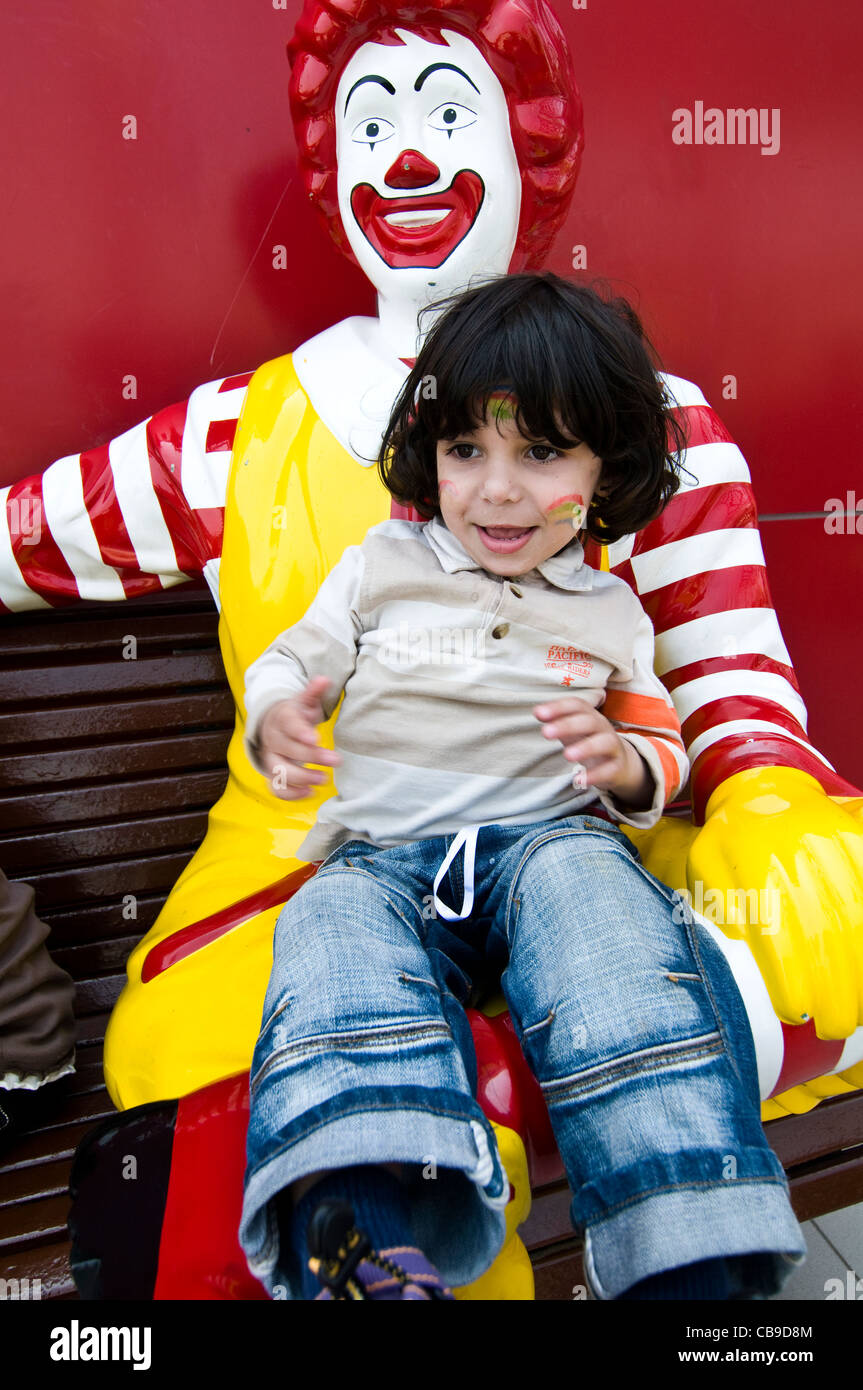 Ronald mcdonald children stock photos ronald mcdonald children a cute boy sitting on ronald mcdonald stock image voltagebd Gallery
