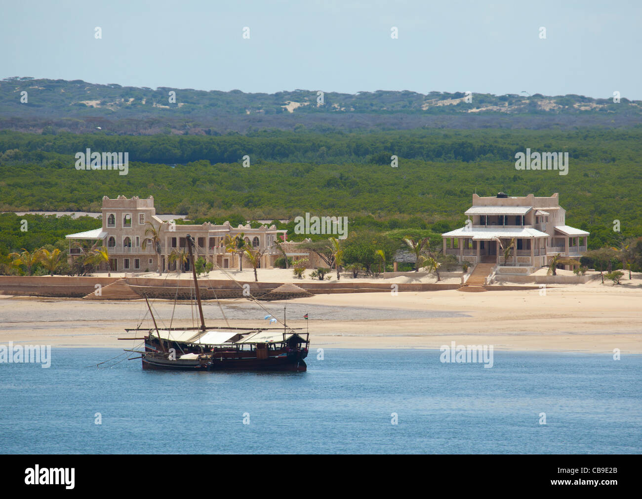 Two dhows seem to be sleeping in the quiet bay of Millionnaire-estates invaded lamu island coast kenya Stock Photo