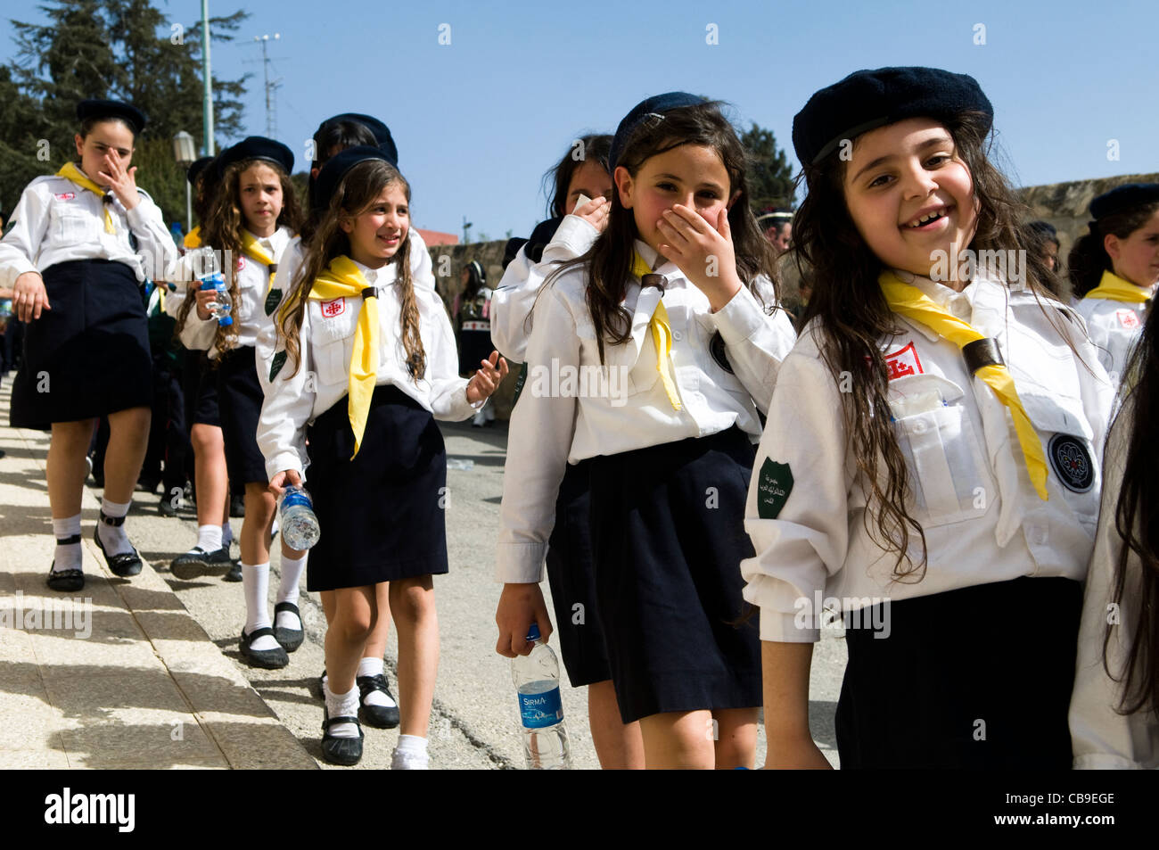 Palestinian girl scouts in a procession. - Stock Image