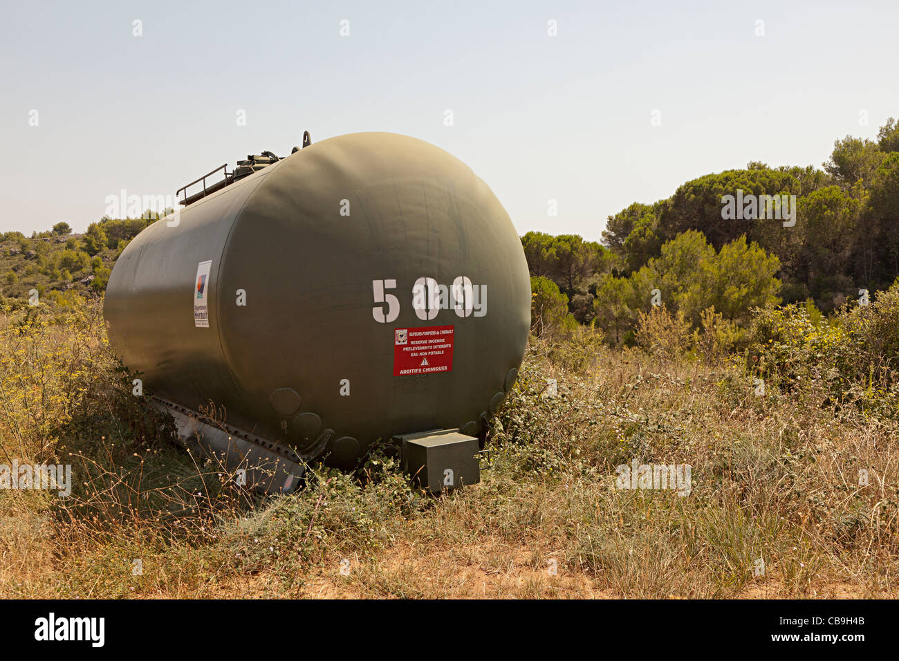 Water tank containing water with chemical additives used for fire control in forest near St-Chinian Herault Languedoc Stock Photo