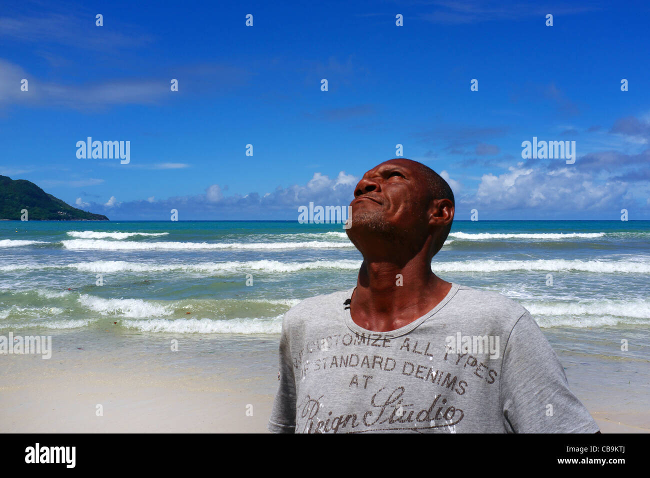 Local fisherman in Seychelles, thanking God for the good catch he had, and asking for similar in the future - Stock Image