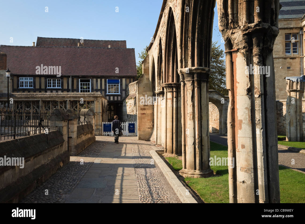 Former Abbey infirmary arches and The King's School Little Cloister House in the Cathedral grounds Gloucester - Stock Image