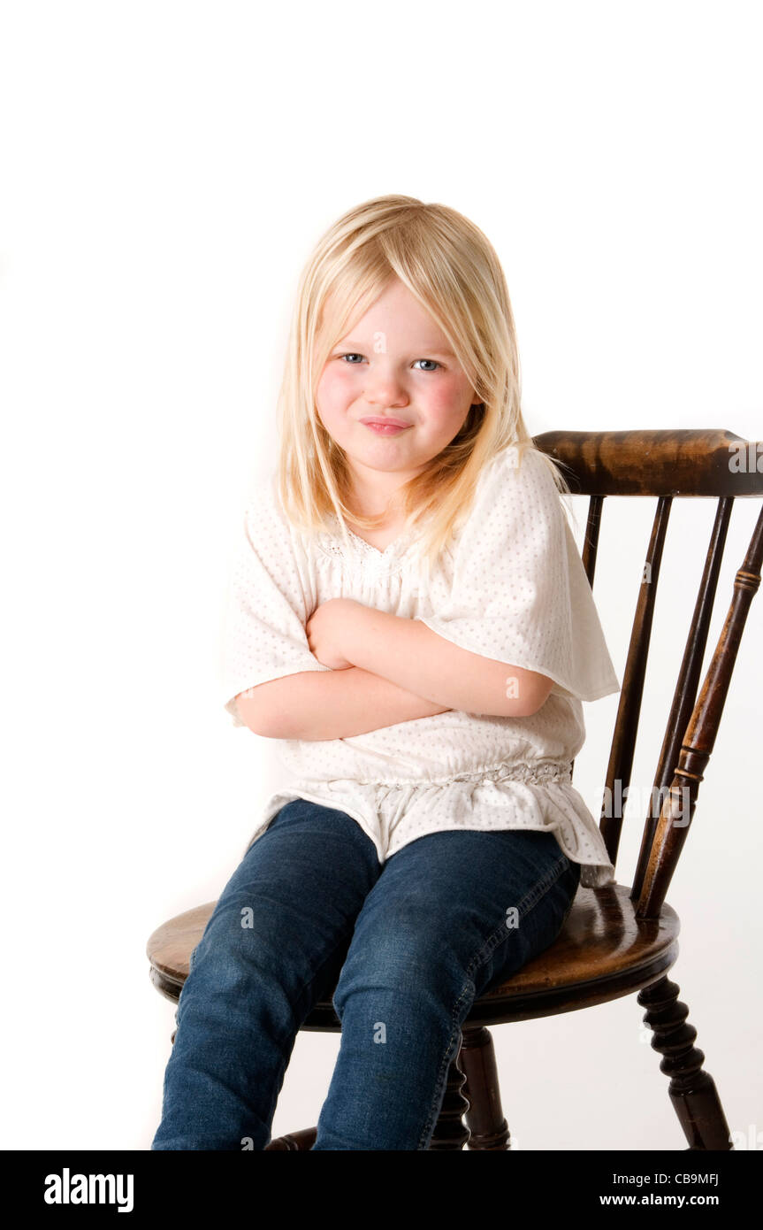 grumpy moody mood hump in a girl young child swing defiant blond kid girl stubborn - Stock Image