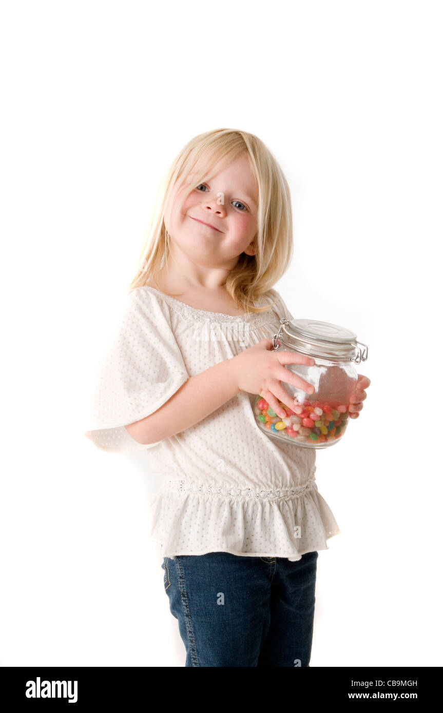 sweet sweets candy jar sweetie sweeties diet sugar child kid girl young children sugary rush jars food diets foods - Stock Image