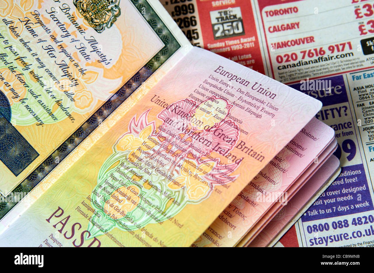 An older style non-biometric British passport showing front page. illustrating travel or holiday planning - Stock Image