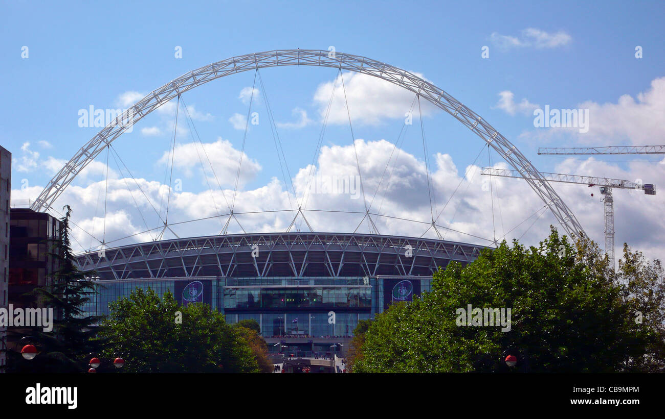 Wembley Stadium with arch, view from the top of Wembley Way by Wembley Park tube station - Stock Image