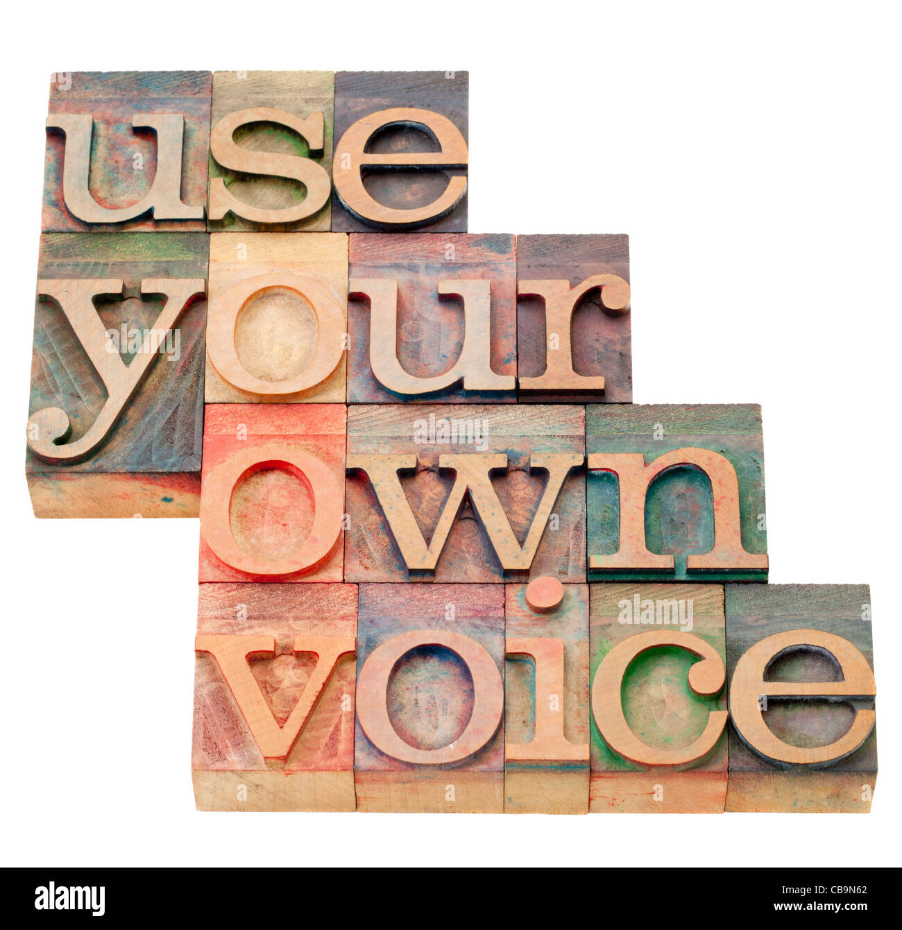 use your own voice advice - isolated text in vintage wood letterpress printing blocks - Stock Image