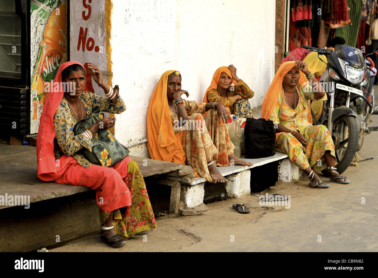 08089647a3 Indian women in traditional dress resting .Pushkar,Rajasthan,India - Stock  Image