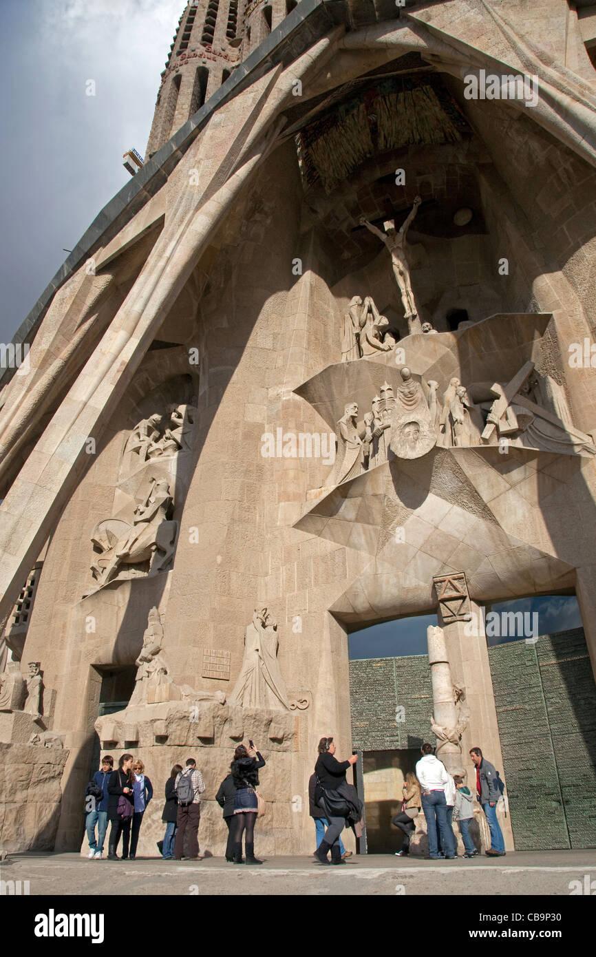 Tourists at entrance of the Basílica Sagrada Família designed by the Catalan architect Antoni Gaudí, - Stock Image