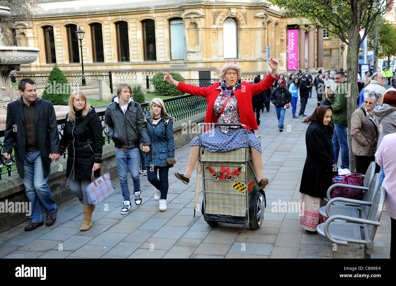 Street entertainer from Granny Turismo on shopping trolley in Wolverhampton England Uk - Stock Image