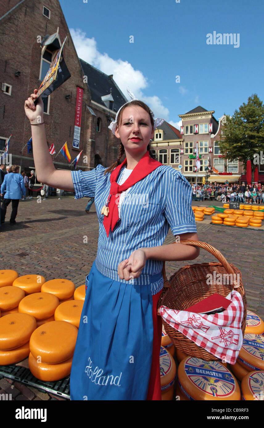 Dutch girl in traditional clothing on the cheese market in