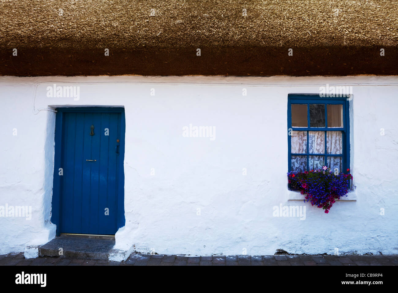 Thatched Cottage in Ardmore Village, County Waterford, Ireland - Stock Image
