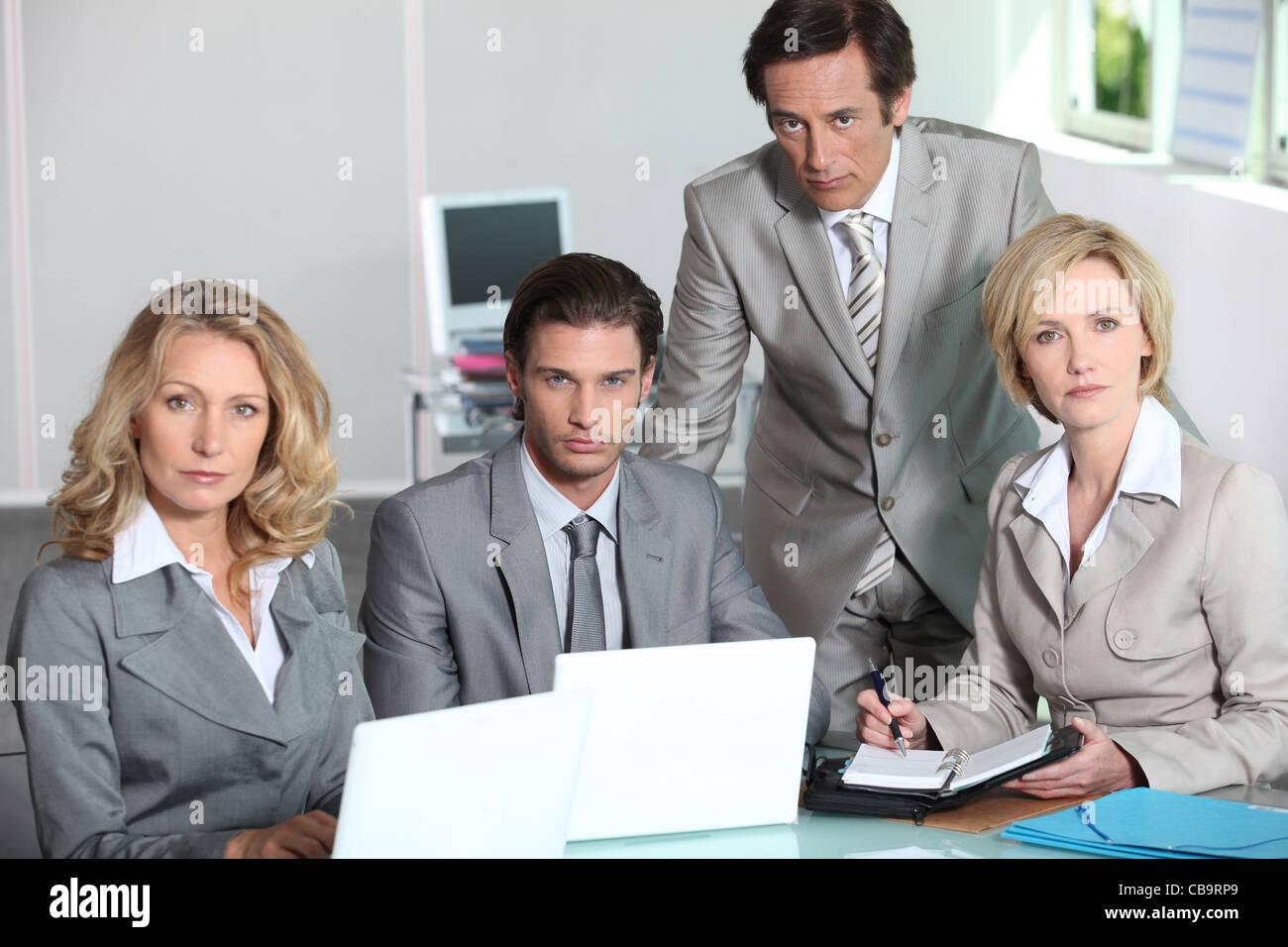 Serious team of executives - Stock Image