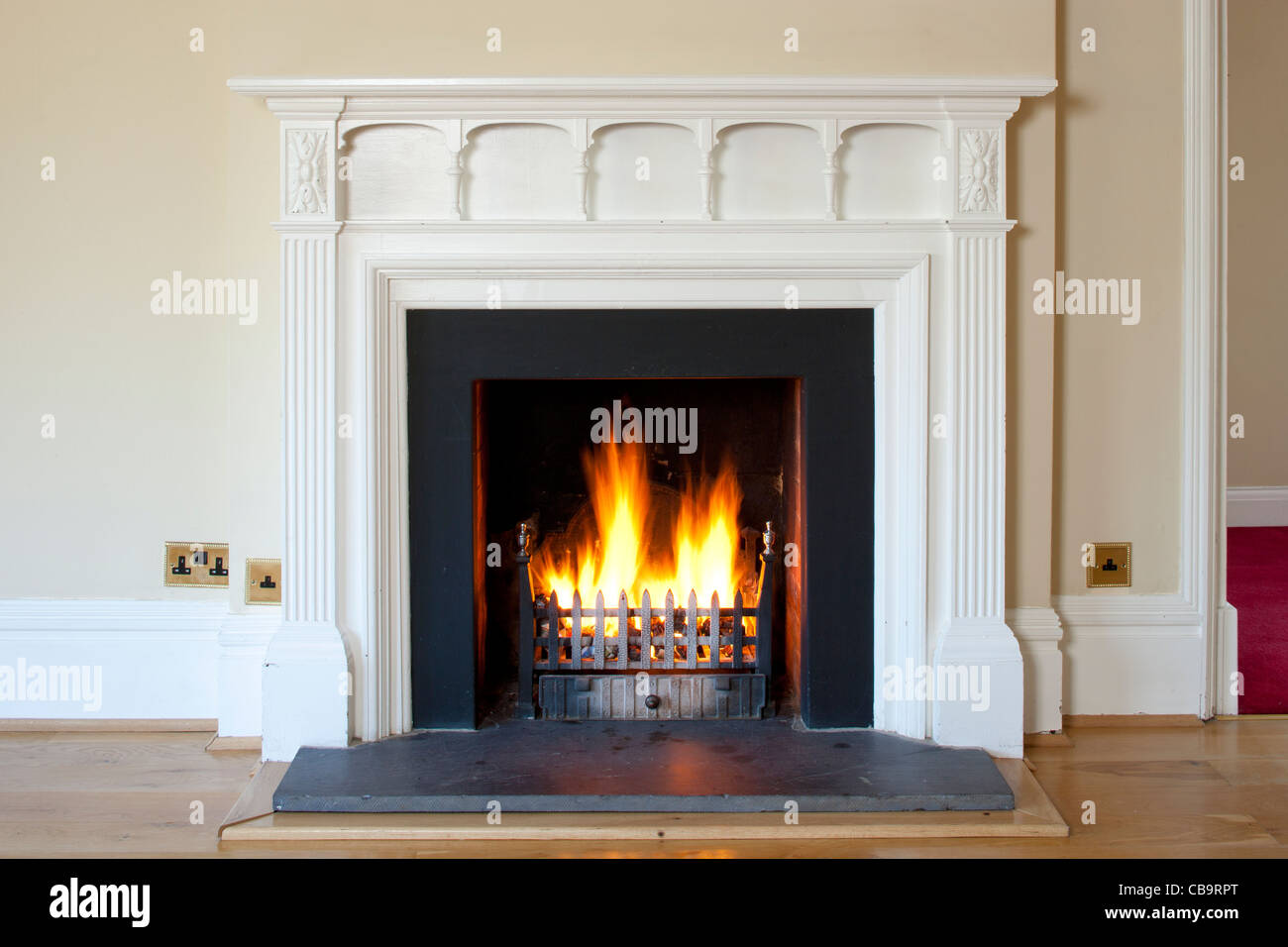 Classical fireplace with burning fire - Stock Image