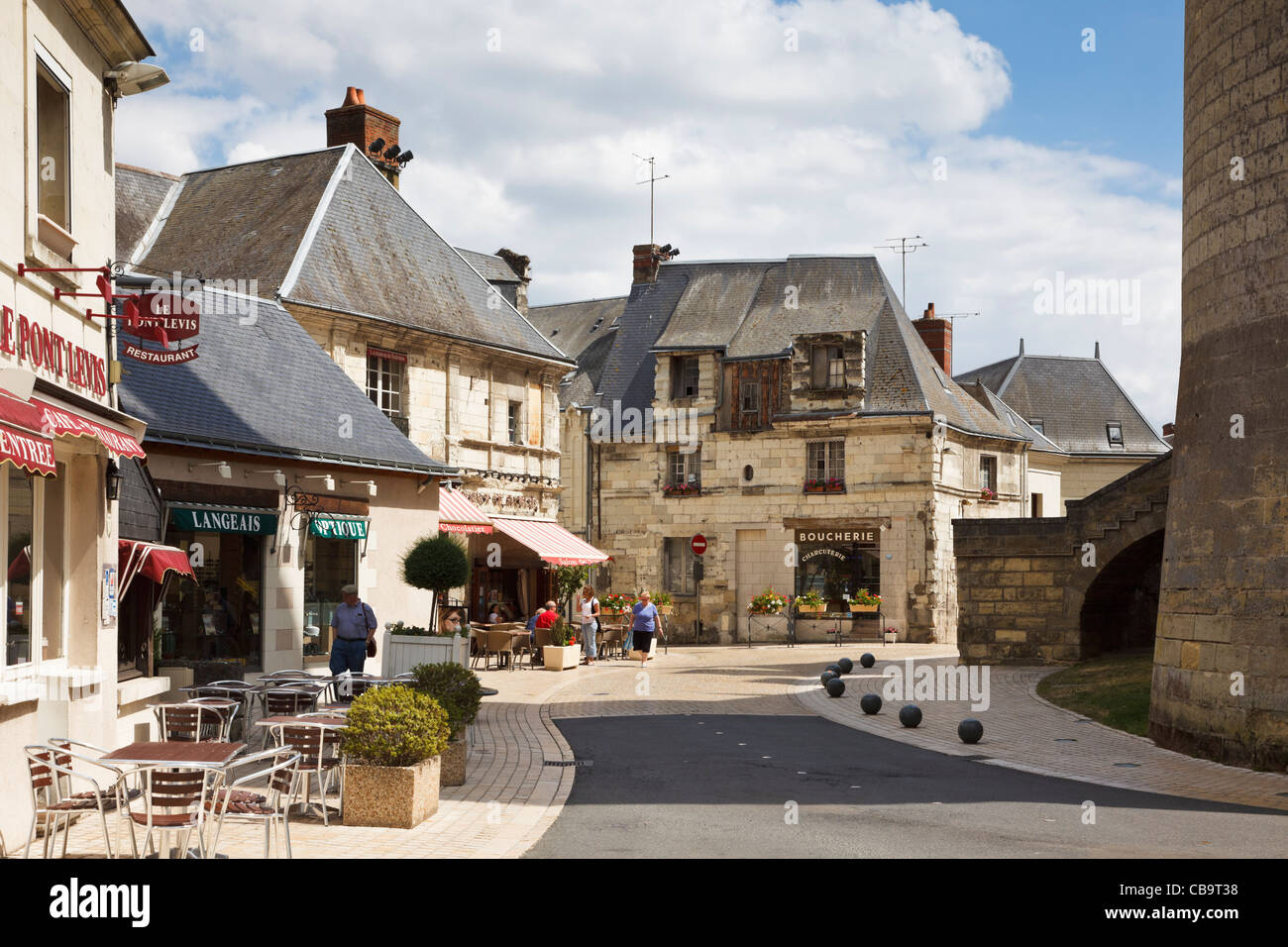 Loire Valley, France - Langeais town centre with chateau walls and cafes, Loire Valley, France - Stock Image