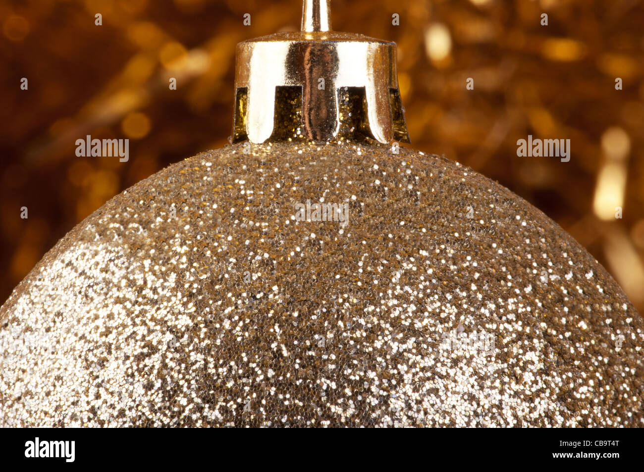 Golden bauble on the Christmas tree. Picture in color gold symbolizes wealth, rich and luxurious Christmas. - Stock Image