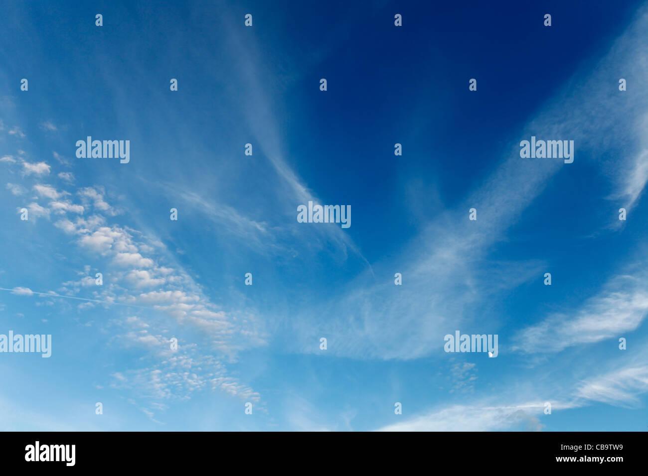 Wispy cloud in summer sky - Stock Image