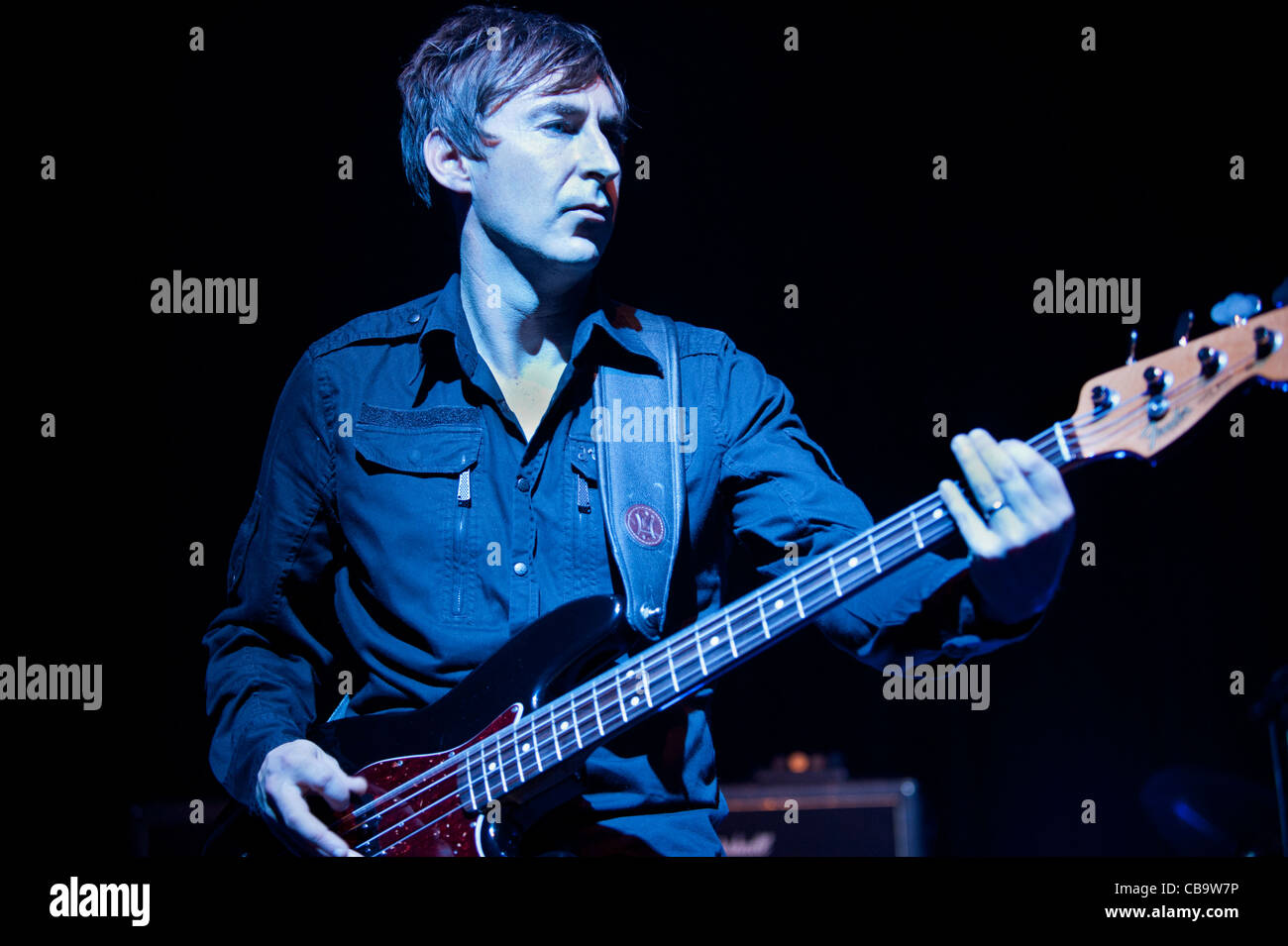 Jon 'Stan' White, bass guitarist,with the band, Magazine, performing at Manchester Academy 4-11-11 - Stock Image
