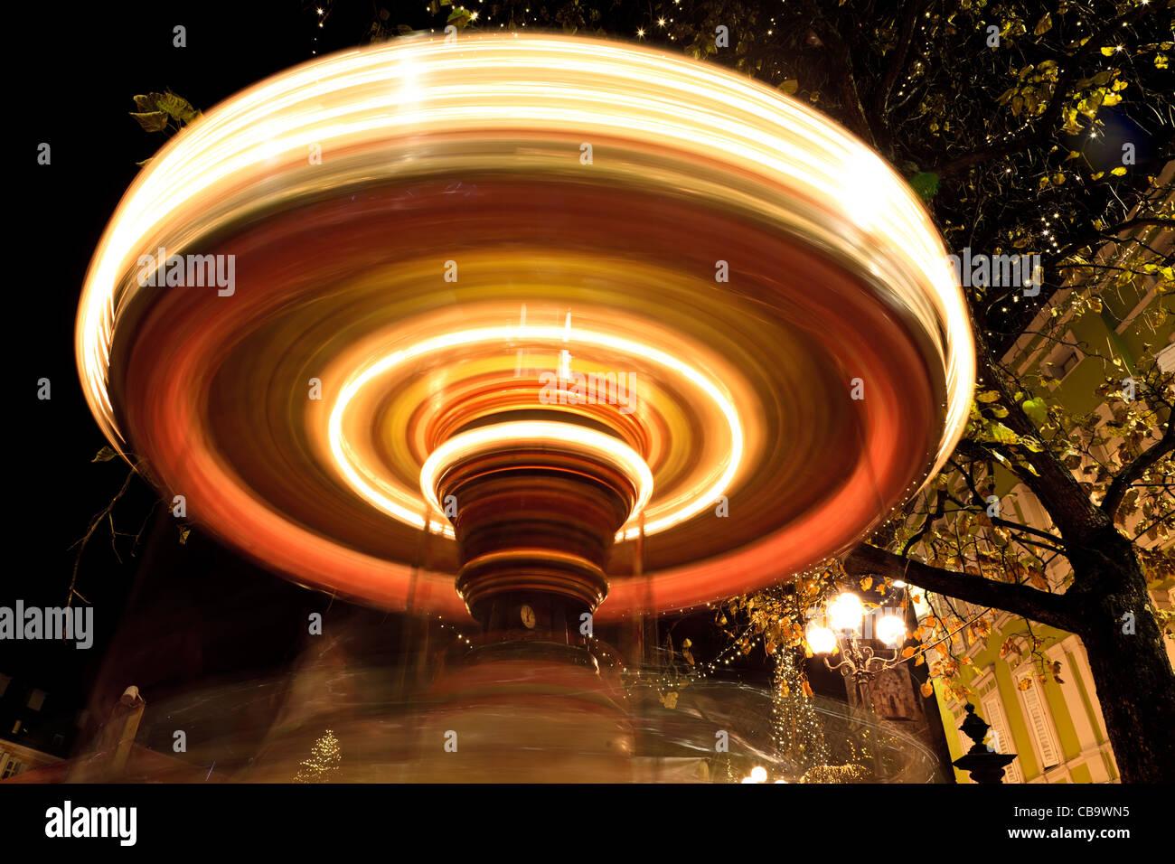 Carousel at night, Bolzano, Alto Adige, Italy - Stock Image