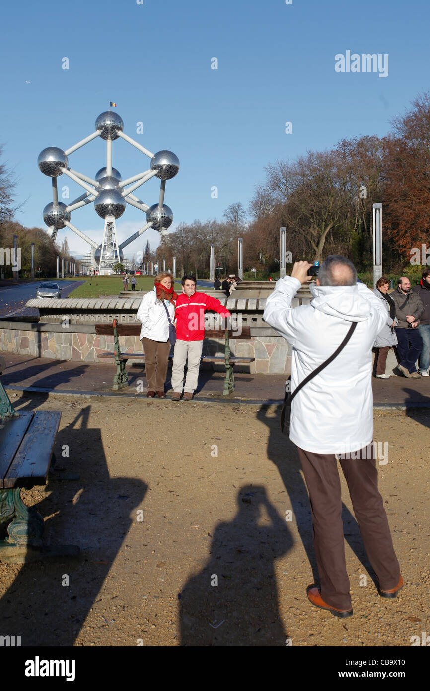 Tourists take pictures in front of the Atomium in Brussels, Belgium - Stock Image