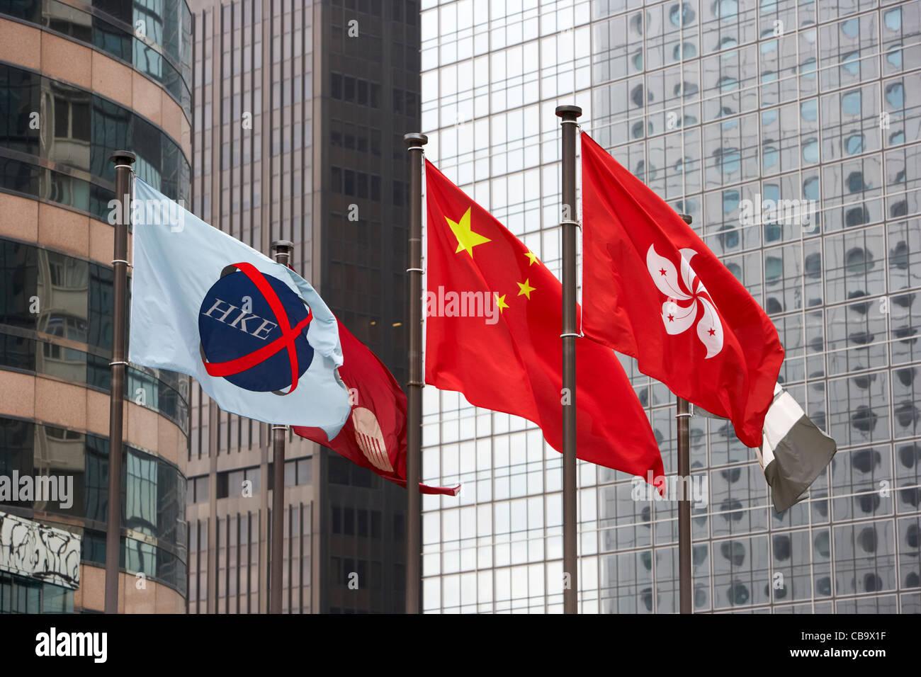 hong kong stock exchange chinese and hong kong flags flying exchange square hong kong hksar china - Stock Image