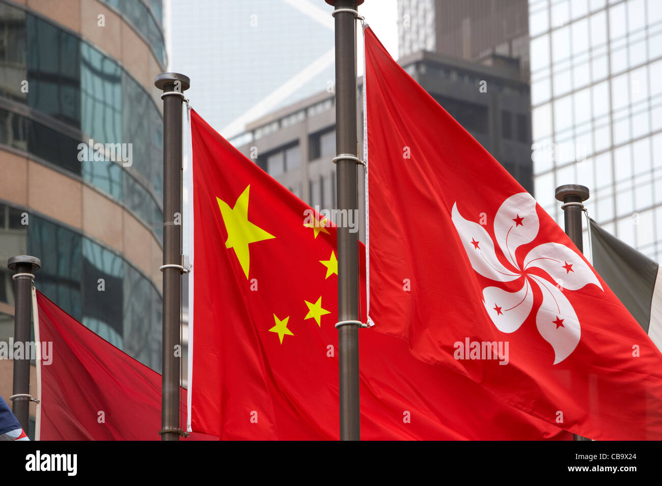 chinese and hong kong flags flying exchange square hong kong hksar china - Stock Image