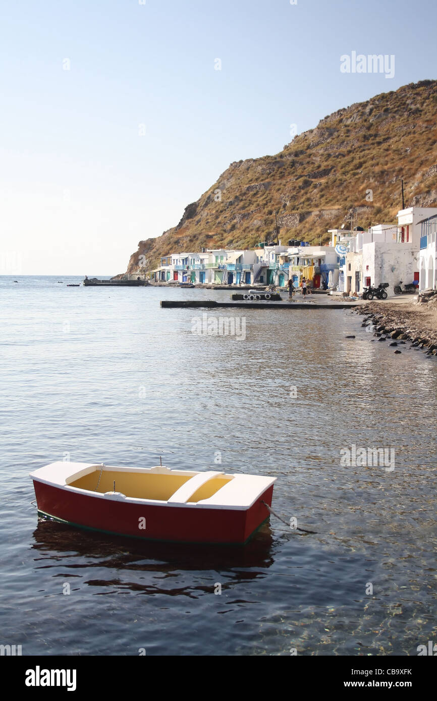 Small boat in the little harbour of Klima, Milos Island, Greece - Stock Image