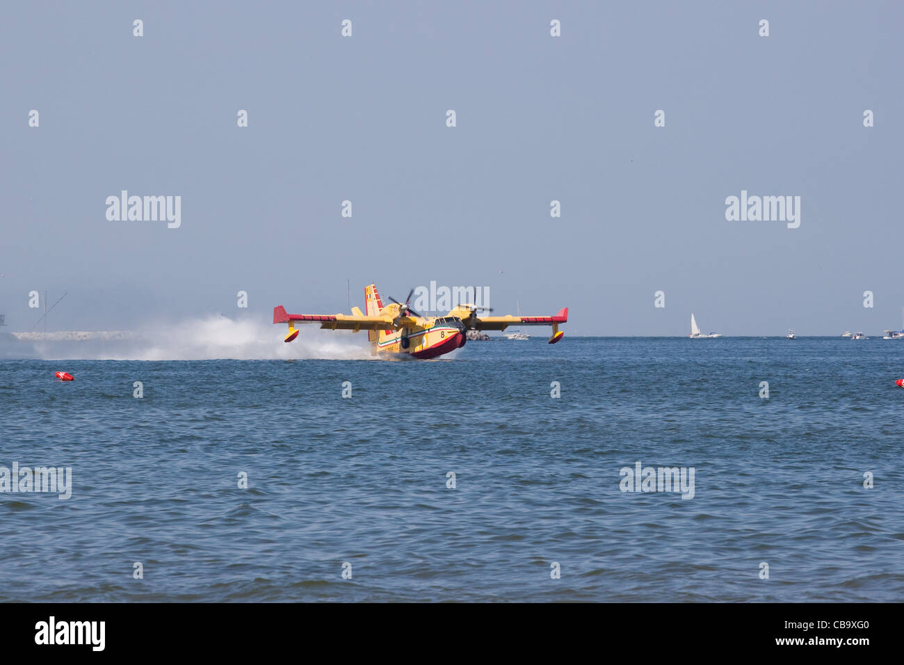 A Canadair 415 in action during an airshow - Stock Image