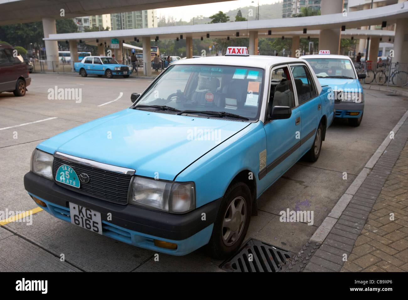 row of lantau island taxis on a taxi rank tung chung hong kong hksar china - Stock Image
