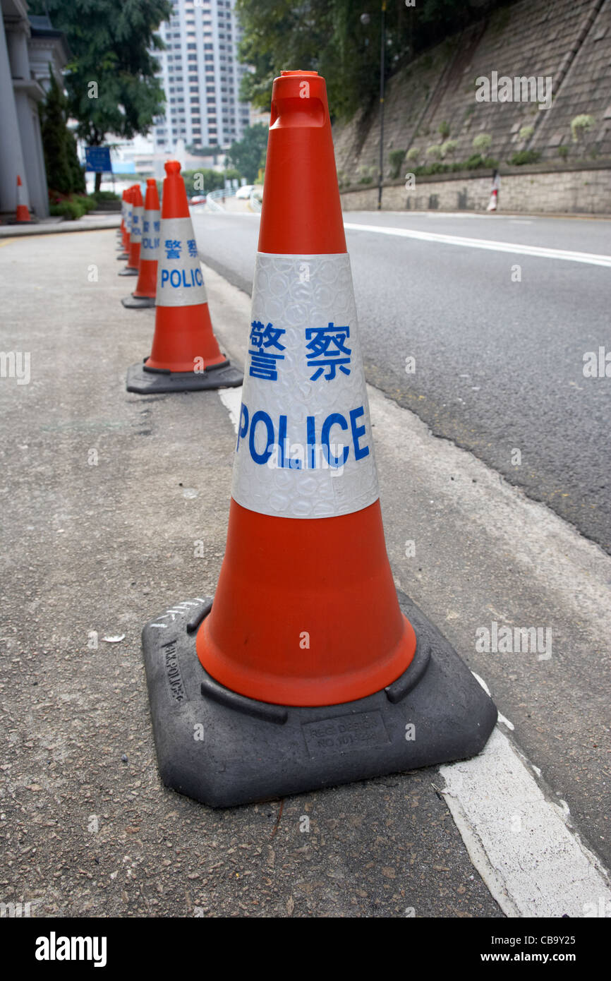 hong kong police traffic cones cordoning off part of a road hksar china - Stock Image