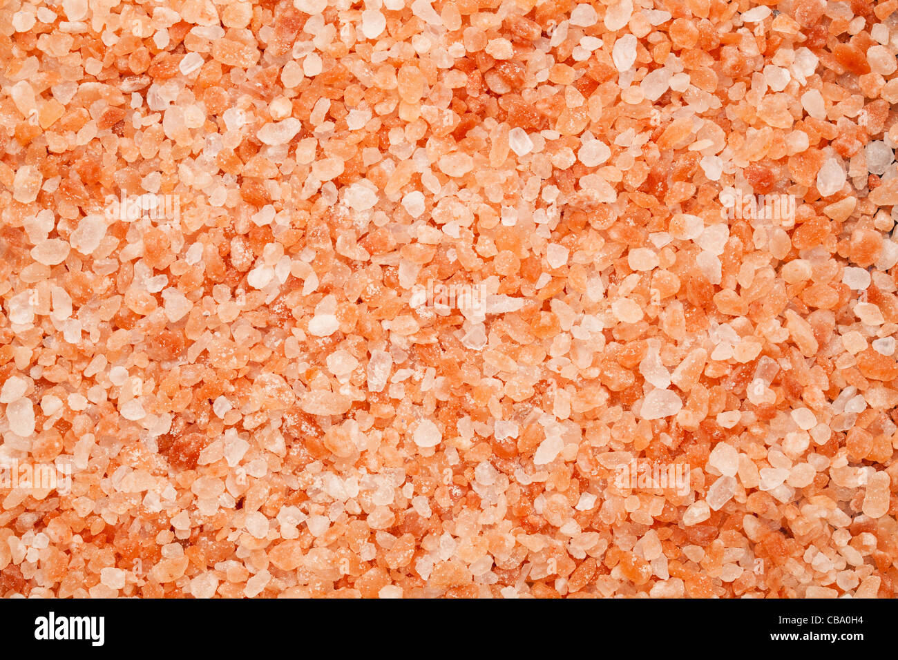 background of Himalayan rock salt - pink and orange coarse crystals - Stock Image