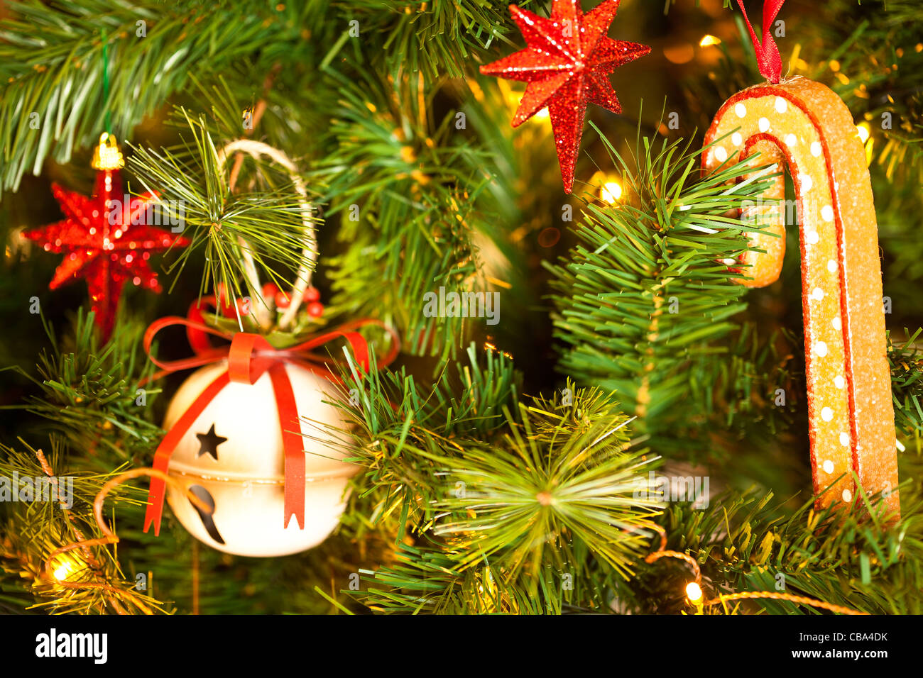 Christmas Decorations hanging in the christmas tree Stock Photo