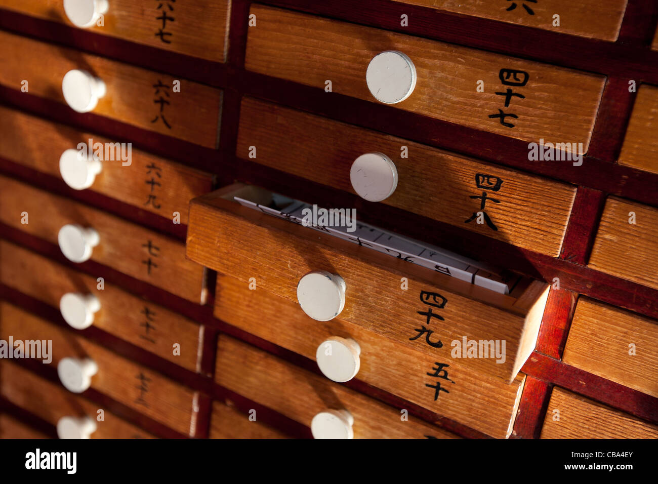 Drawers containing fortune-telling leaflets, known as omikuji, at Senso-ji Temple, in Asakusa district of Tokyo, - Stock Image