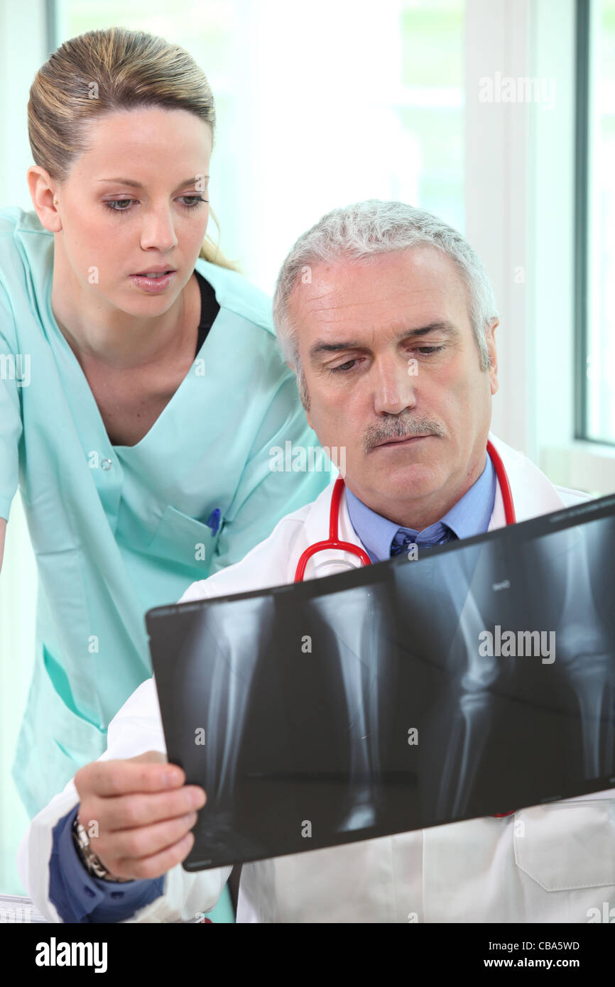Radiologist and assistant - Stock Image