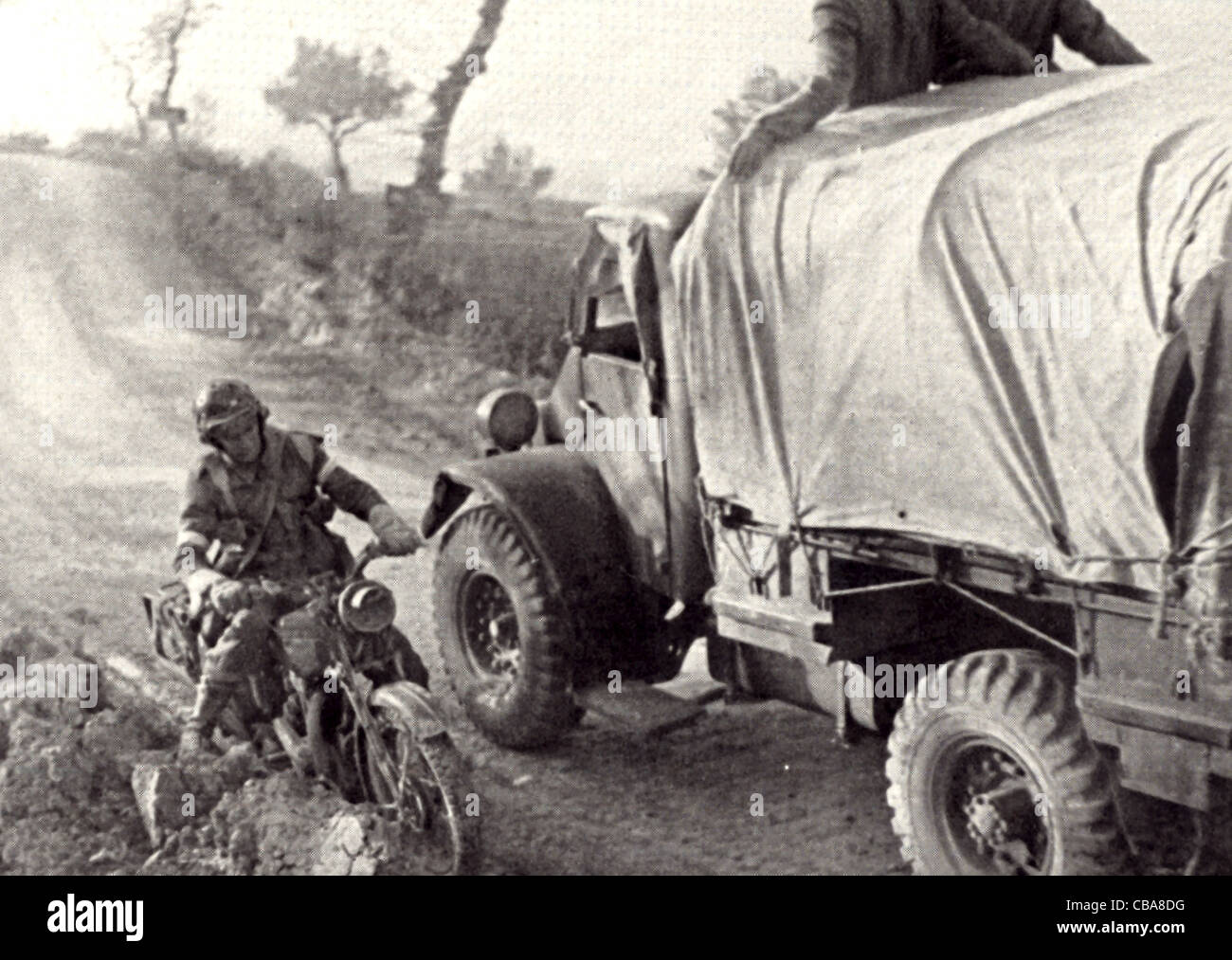 A British dispatch rider courier passes a truck on an Italian road
