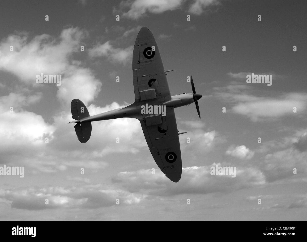 A SUPERMARINE SPITFIRE AGAINST THE SKY. - Stock Image