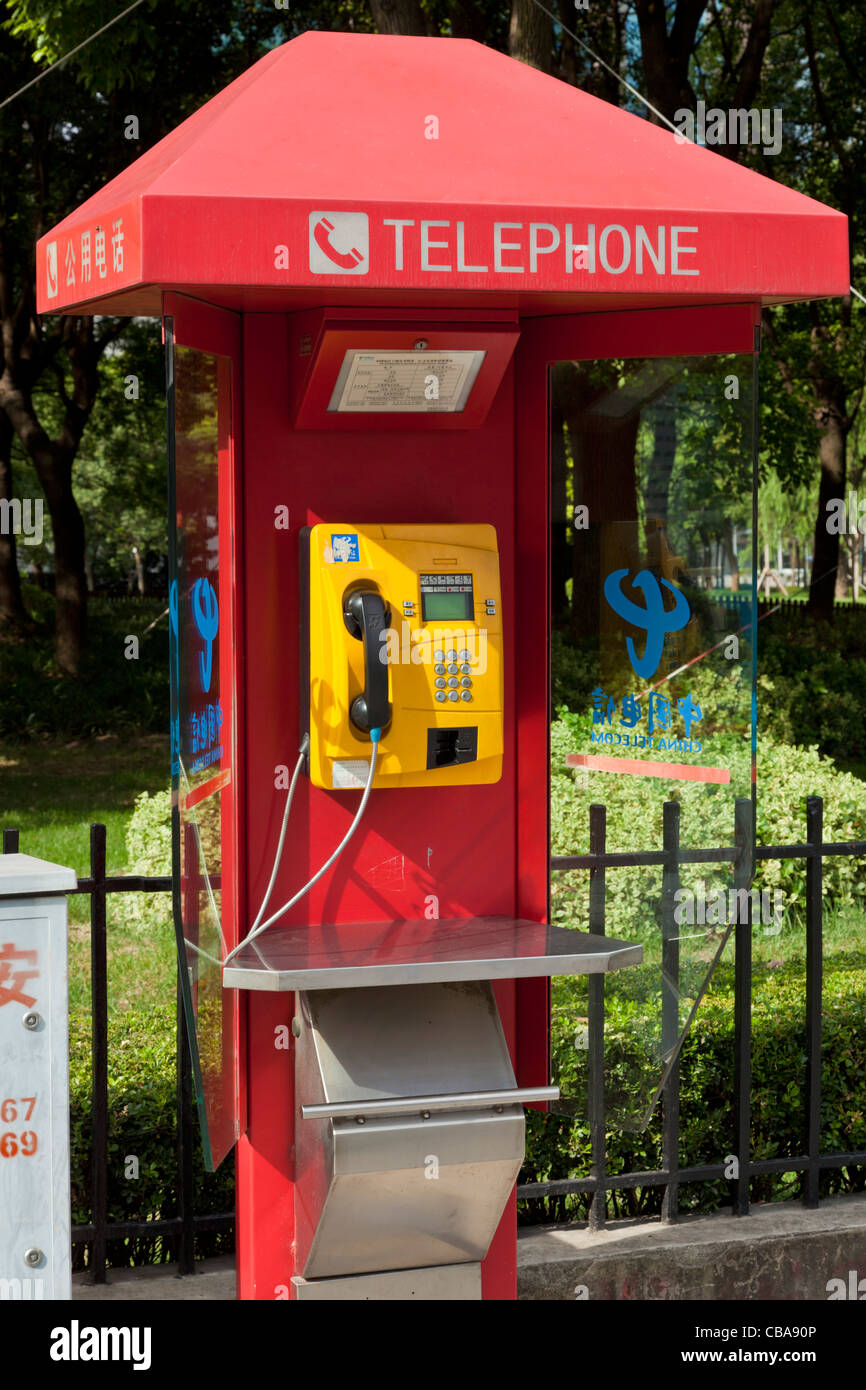 Red chinese public telephone kiosk Shanghai PRC, People's Republic of China, Asia - Stock Image