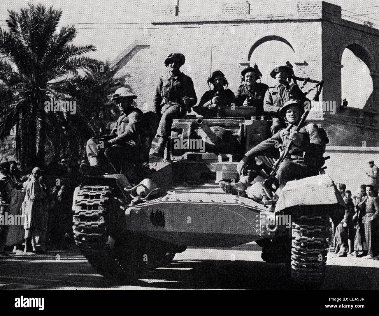 A British Valentine tank with highland infantry in North Africa during WW11. - Stock Image