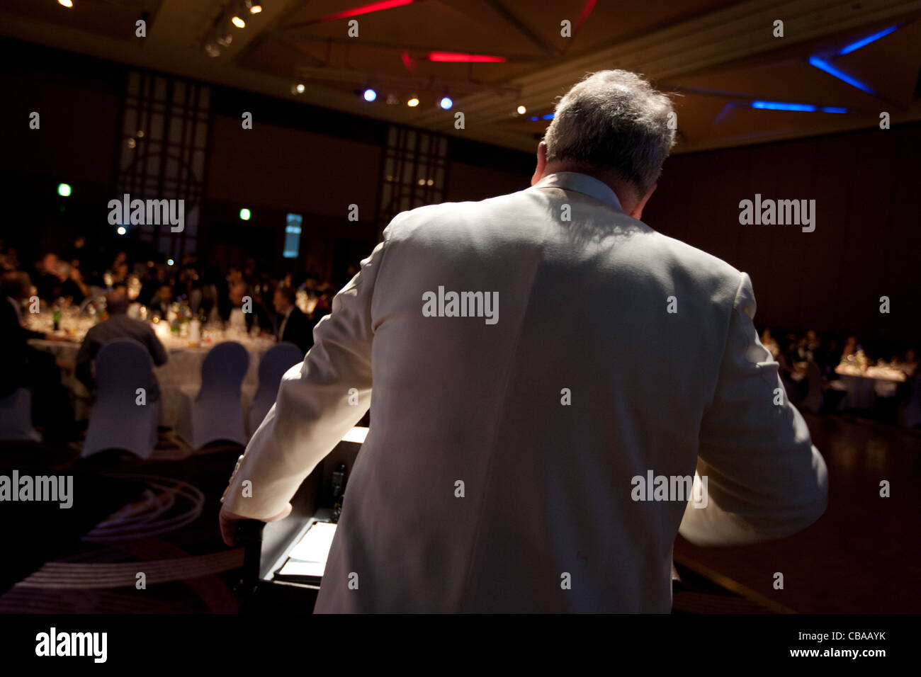 Master of ceremonies, MC, compere,  at an evening function, Japan. Stock Photo