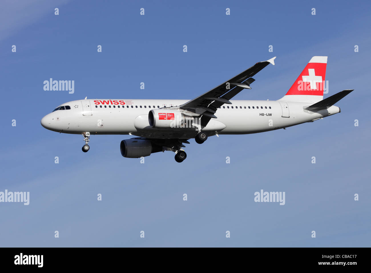 Swiss International Air Lines Airbus A320-214 HB-IJW on approach to Heathrow - Stock Image