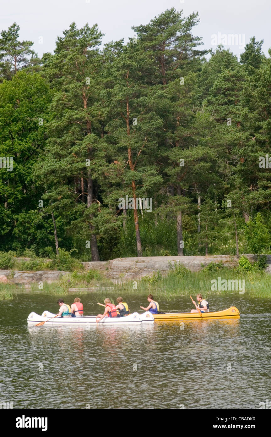 canoe canoing on swedish lake water sweden canoes forest outdoor lifestyle - Stock Image