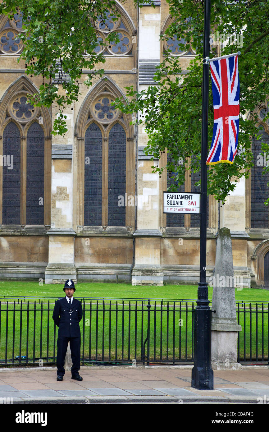 Police officer in Parliament Square standing guard outside Westminster Abbey during the marriage of Prince William - Stock Image