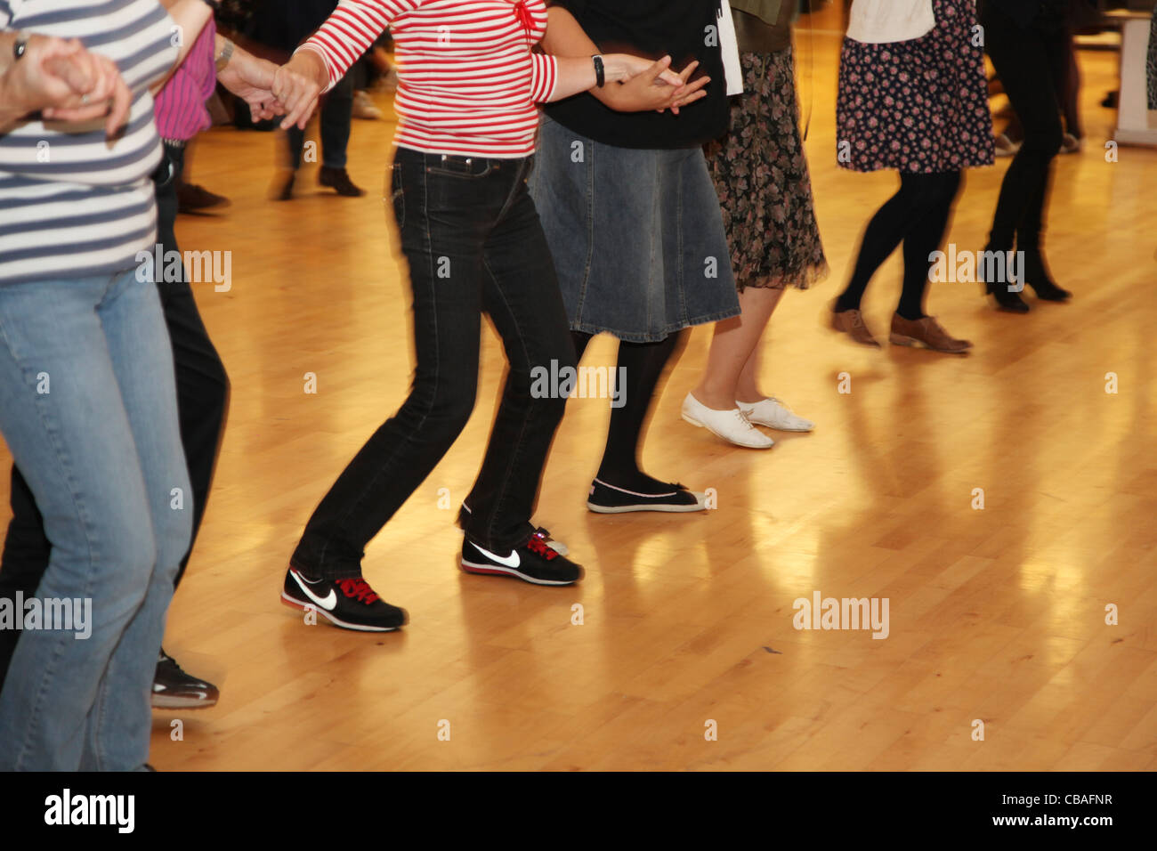 Barn dance in a village hall - Stock Image