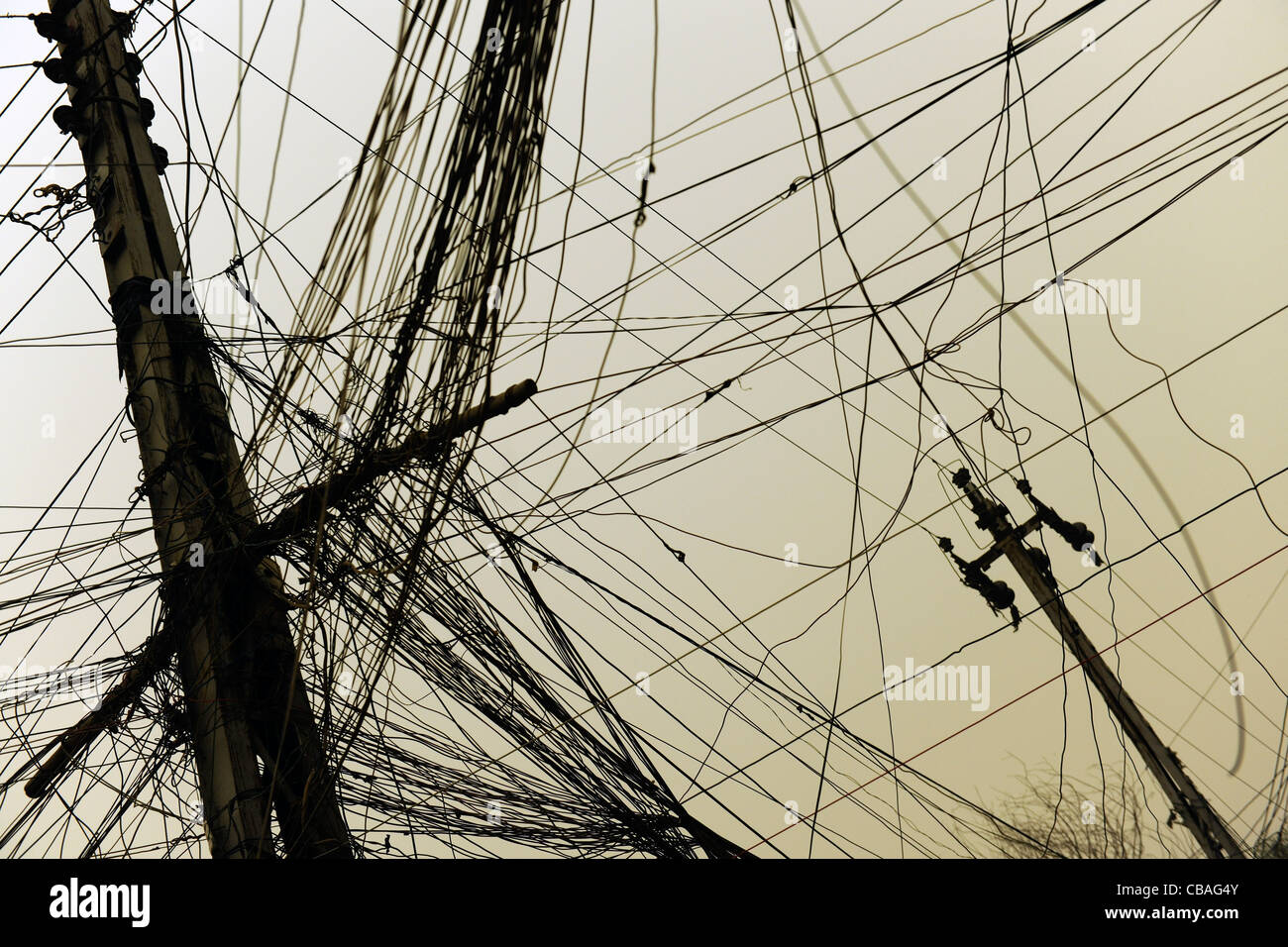 Power lines strung across streets have replaced the municipal electricity grid which is marred by corruption - Stock Image
