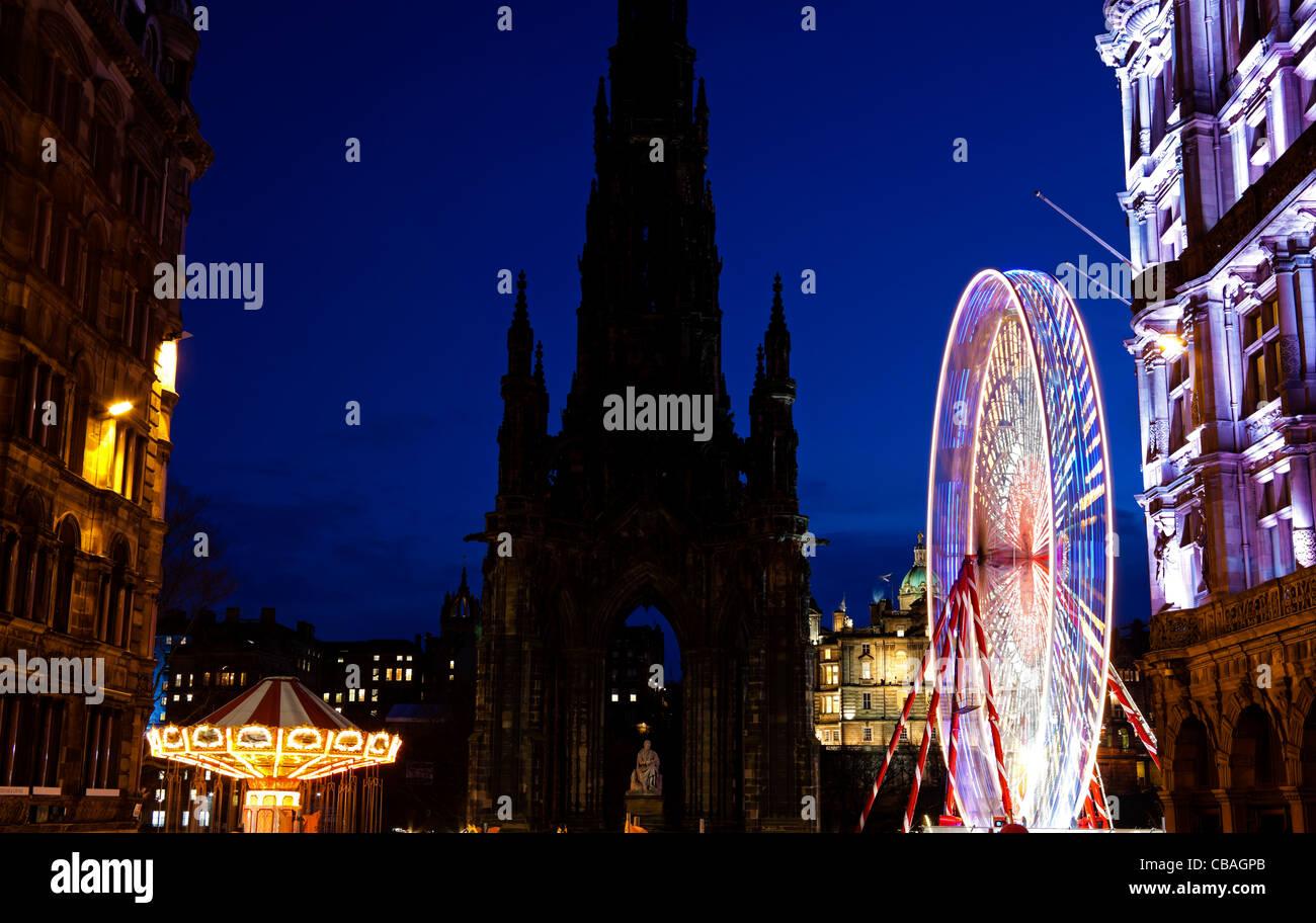 Edinburgh Christmas Fun Fair with Scott Monument Princes Street Scotland UK Europe Stock Photo