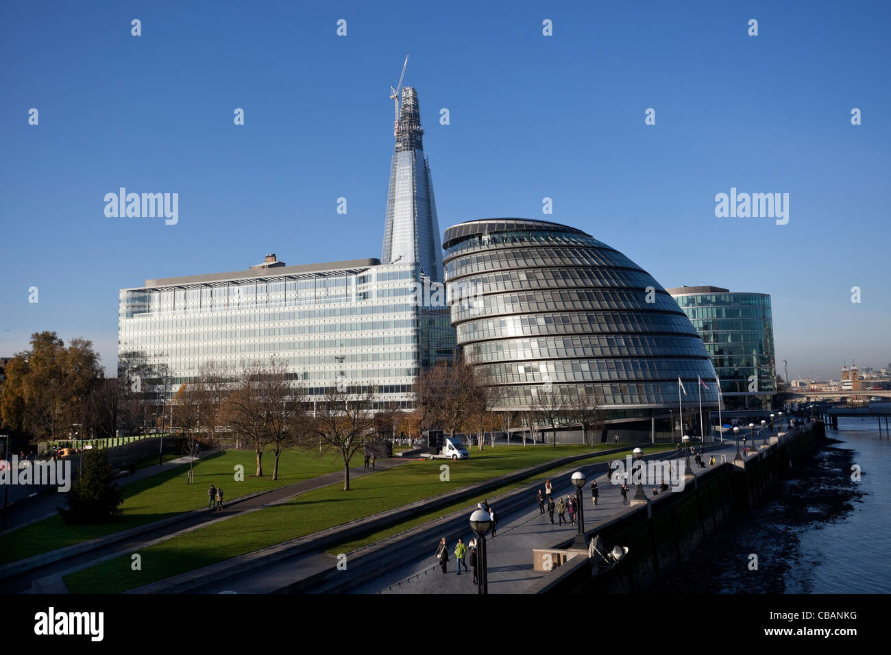 View of the London Assembly Building with the Shard building construction in the backgroung, England, UK, 2011 - Stock Image