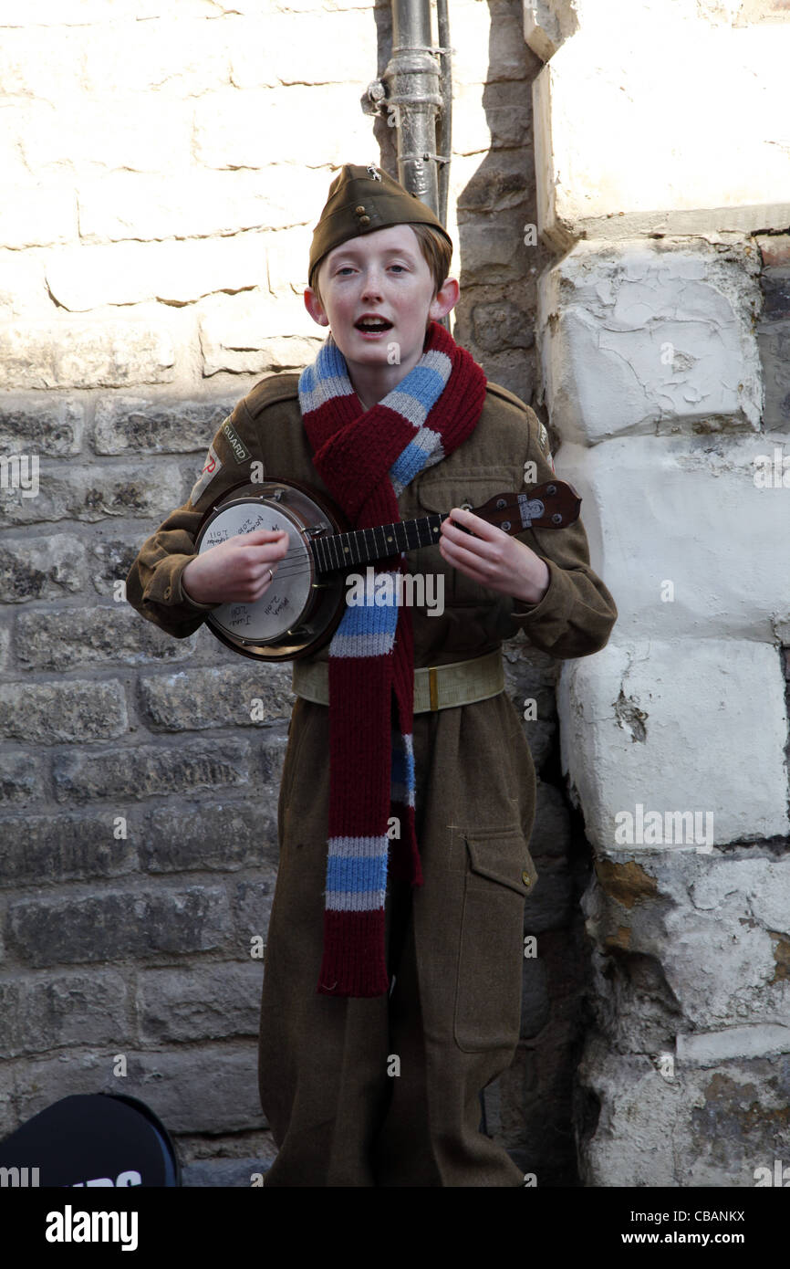 YOUNG HOME GUARD BOY WITH BANJO PICKERING NORTH YORKSHIRE 15 October 2011 - Stock Image