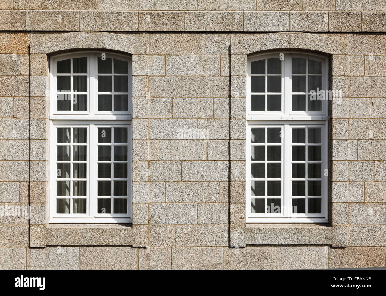 Two windows in a large old house - Stock Image