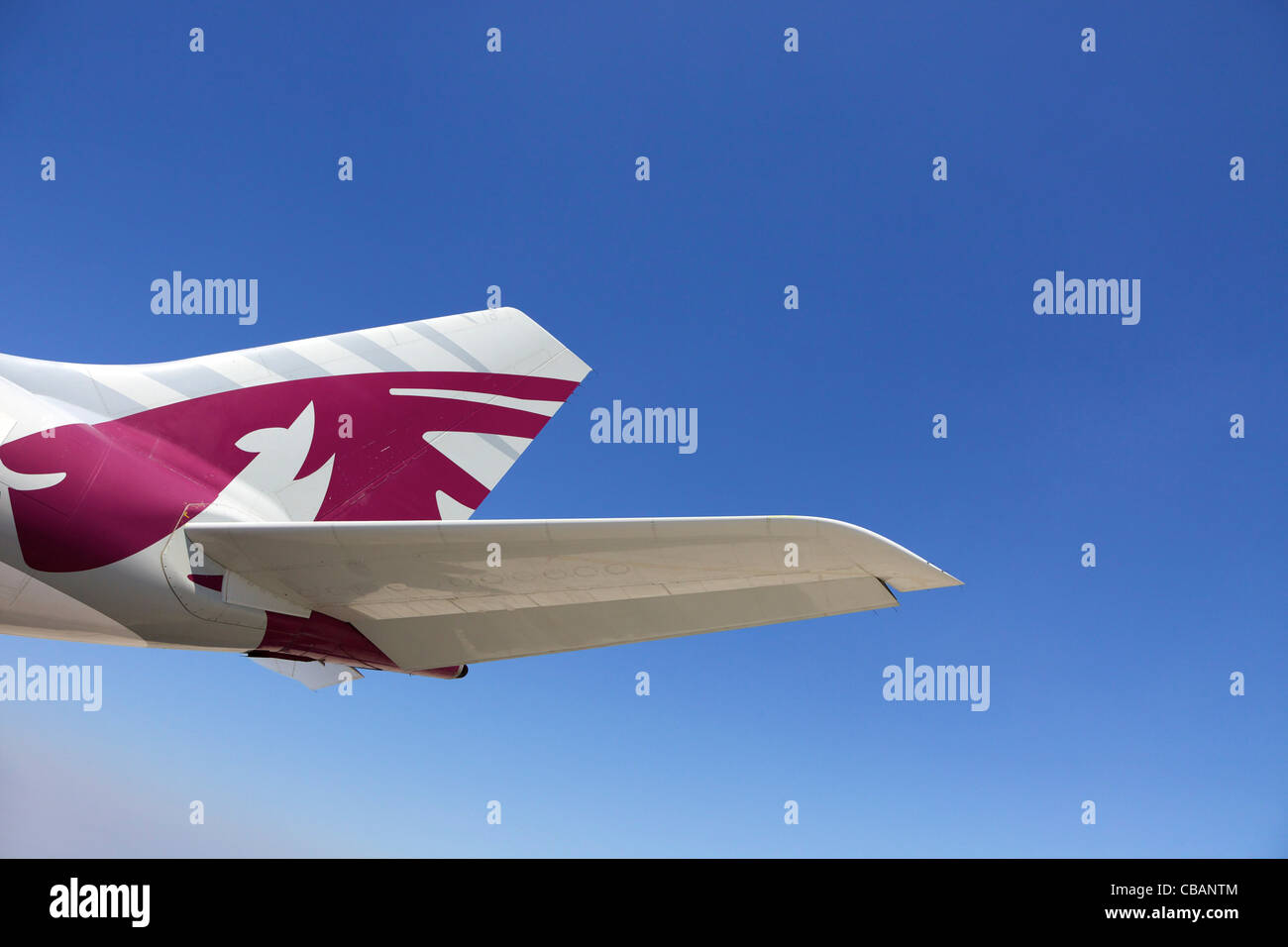 Qatar airliner tailfin at Doha International Airport, Qatar, Middle East - Stock Image